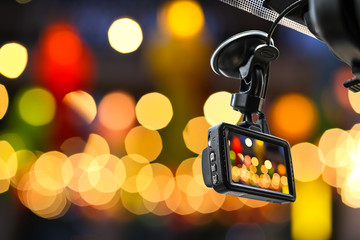 CCTV car camera for safety on the road accident on abstract blurred bogey light of city in night background.
