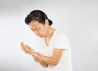 old asian woman feel wrist bones injury
