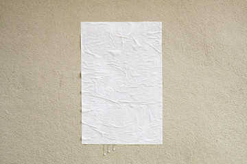 Blank white crumpled and creased adhesive street poster mockup on concrete wall background