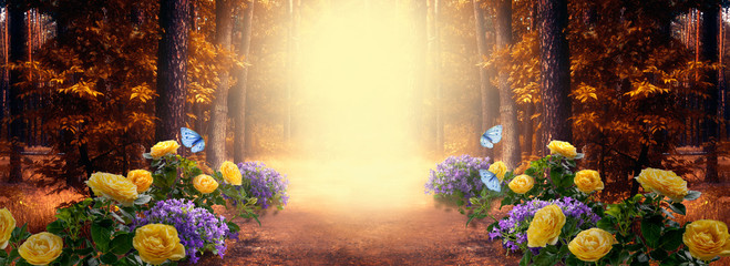 Fantasy fabulous wide panoramic photo background with autumnal pine tree forest, summer rose and bluebell campanula flower bush, flying blue butterfly and mysterious foggy trail road with copy space
