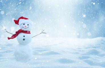 Wall Mural - Happy  snowman standing in christmas landscape.Snow background.Winter fairytale.Merry christmas and happy new year greeting card with copy-space.