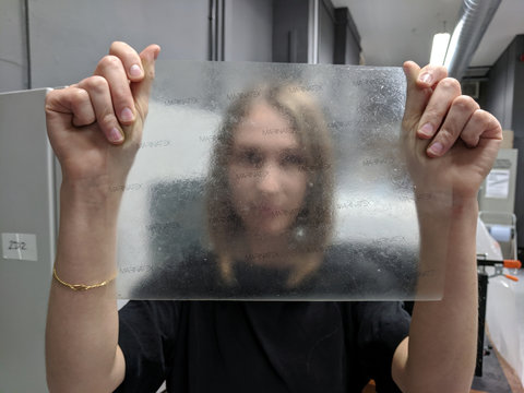 Product design graduate Lucy Hughes holds up a sheet of MarinaTex - an edible and compostable plastic alternative made from byproducts of the fishing industry and other natural ingredients which has won the James Dyson Award, in Brighton