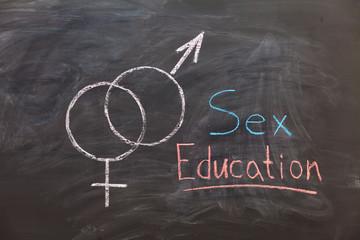 Sex Education. Male and female sex symbol on black chalkboard