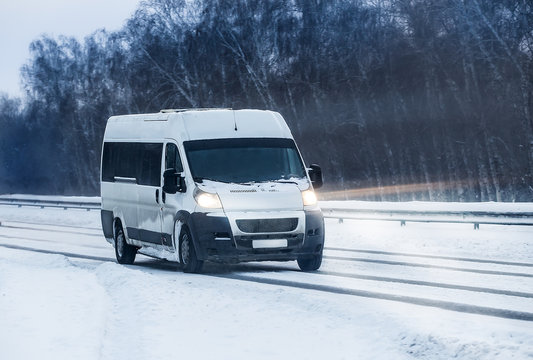 Minibus moves in the winter on a highway