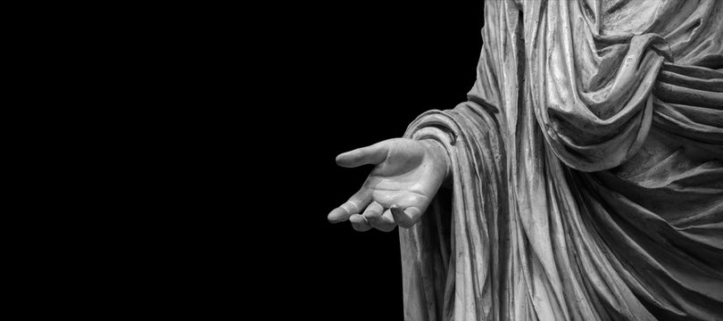 Man hand on antique tunic. Stone statue detail of human hand. Folds in the fabric. Copyspace for text