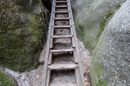 stairs leading through rocks. where do you want to go today?