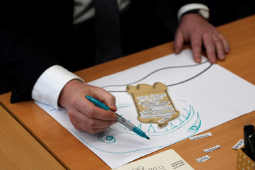 Britain's Prime Minister Boris Johnson makes a drawing during his visit to the West Monkton CEVC Primary School during a general election campaign trail in Taunton