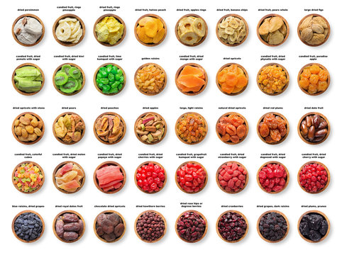 collection candied and dried fruits, sundried berries isolated on white background. dates, pineapple, figs,  apricots, prune, raisins, apples, pears, peach,  plums,  grapes and other organic foods.