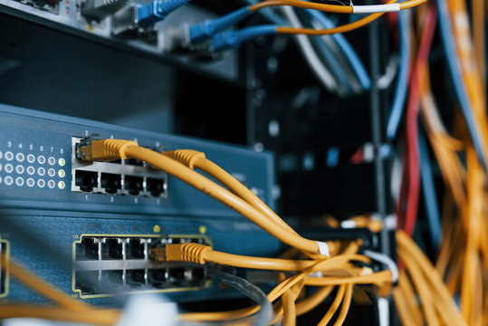 Close up view of internet equipment and cables in the server room