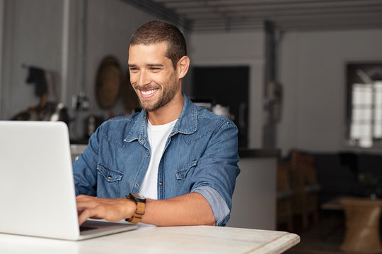 Happy guy using laptop
