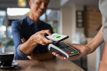 Woman paying using NFC technology