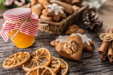 Gingerbread christmas cookies with jar of honey on kitchen table - Close-up
