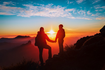 mother and son travel in mountains at sunset, family hiking in nature Fotomurales