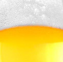 Background of beer with foam and bubbles.