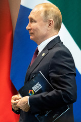 Russia's President Vladimir Putin leaves a meeting with members of the Business Council and management of the New Development Bank during the BRICS emerging economies at the Itamaraty palace in Brasilia