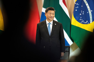 China's President Xi Jinping arrives for a meeting with members of the Business Council and management of the New Development Bank during the BRICS emerging economies at the Itamaraty palace in Brasilia