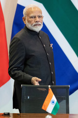 India's Prime Minister Narendra Modi arrives for a meeting with members of the Business Council and management of the New Development Bank during the BRICS emerging economies at the Itamaraty palace in Brasilia