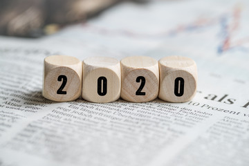 cubes with number 2020 on a newspaper