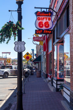 Williams, Arizona, USA: May 24, 2019: Street view with souvenir shops and neon billboards in Williams, one of the cities on the famous route 66