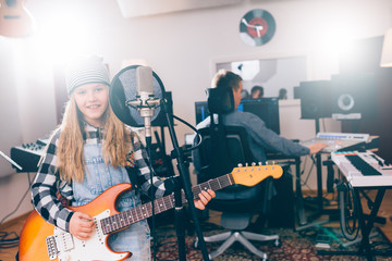 kids rock band playing in music studio
