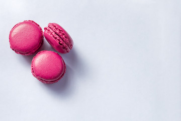 Autocollant pour porte Macarons Colorful french macarons cookies(macaroons) on a light background with copy space for postcard, banner, cover. Dessert for served with tea or coffee break.