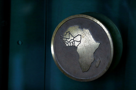 Economic Community Of West African States map is seen illustrated on a door handle at the Ecowas secretariat in Abuja