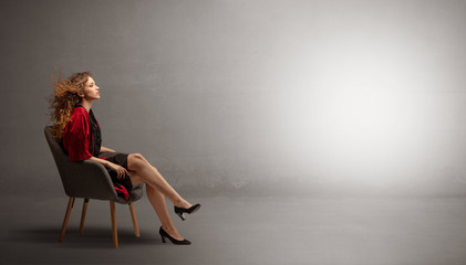 Young beautiful woman modeling in an empty studio