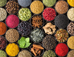 Fototapete - Bright spice background, top view. Collection  seasoning and herbs of Indian food