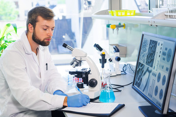 Scientist working in lab. Doctor making microbiology research. Laboratory tools: microscope, test tubes, equipment. Biotechnology, chemistry, bacteriology, virology, dna and health care.