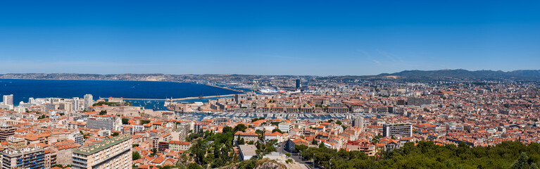 Marseille harbor. Panoramic summer view on Marseille rooftops with Vieux Port and the Mediterranean Sea. Bouches-du-Rhône (13), Provence-Alpes-Cote d'Azur, France, Europe