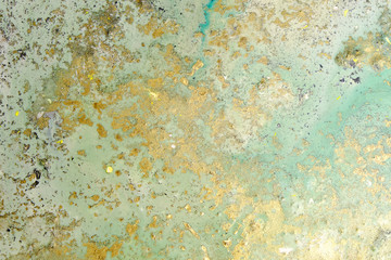 Acrylic artwork with golden stains. Abstract modern art on canvas. Grunge effect.