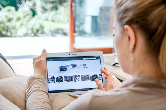 WROCLAW, POLAND- APRIL 10th, 2017:  Woman launches amazon application on Lenovo tablet. Amazon is an American electronic commerce and cloud computing company