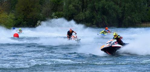 Tuinposter Water Motor sporten Jet Ski race competitors cornering at speed creating at lot of spray.