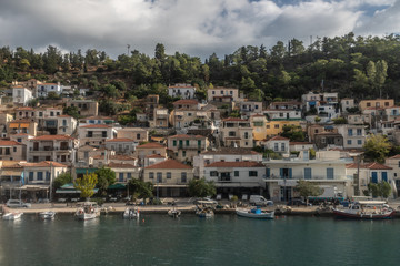 Foto op Canvas Barcelona Boats and houses in a village in Poros Island