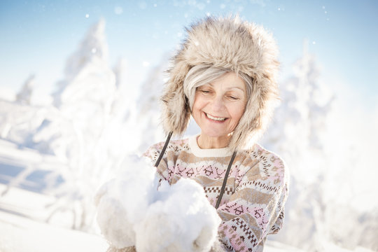 healthy, young at heart senior active in winter holidays has fun and is vital and fit