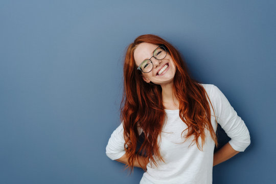 Happy attractive young redhead woman