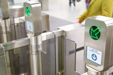 Toronto TTC Metrolinx Presto machines at a busy Bloor and Yonge station.  A contactless smart card is used to gain access to public transportation.