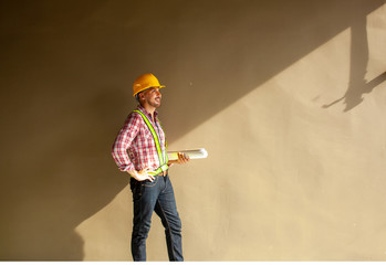 Poster Dance School Construction engineer or worker or foreman holding Blueprint standing in construction site.Construction Engineering,foreman and worker concept.
