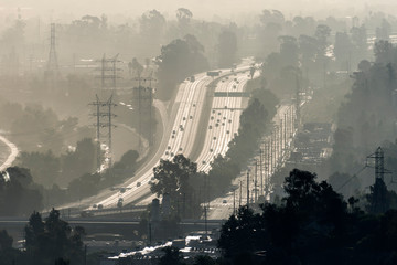 Hazy smoggy view of the 5 freeway near Riverside Drive, Griffith Park and the Los Angeles River in Southern California.   Fotobehang