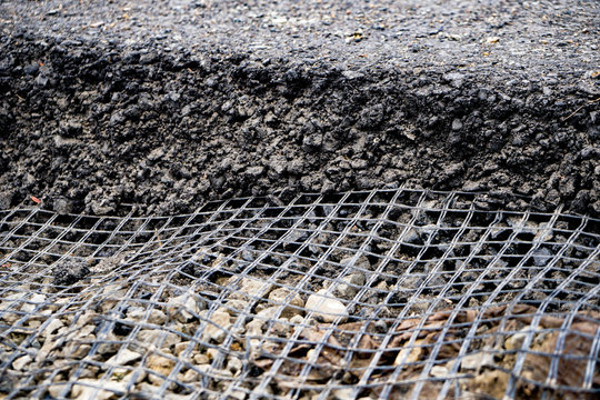 small geogrid reinforcing a new roadbed, road construction, asphalt laying, modern technologies