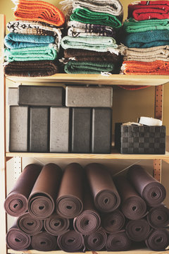 Yoga studio blocks, mats, blankets and other props.