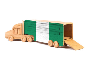 Close-up of a wooden toy truck with a painted national flag Nigeria. The concept of export-import,transportation, national delivery of goods