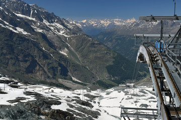 Metro Alpin funicular pylon with saas fee mountain landscape in the background