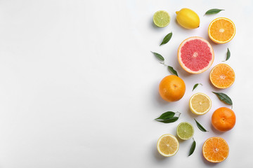 Fototapete - Flat lay composition with tangerines and different citrus fruits on white background. Space for text