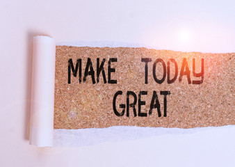 Conceptual hand writing showing Make Today Great. Concept meaning Motivation for a good day Inspiration Positivity Happiness Cardboard which is torn placed above a wooden classic table