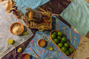 Aluminium Prints Picnic Table with mezcal and lemons