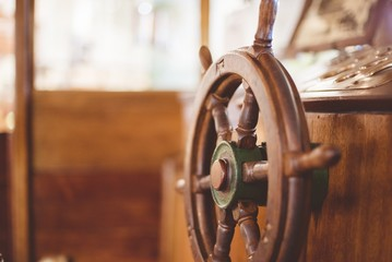 Closeup shot of a boat steering wheel with a blurred background
