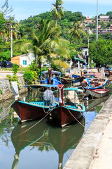 Boats moored in the canal behind Bang Tao beach