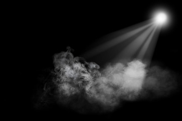 Photo sur Aluminium Lumiere, Ombre Abstract powder or smoke effect with spotlight isolated on black background