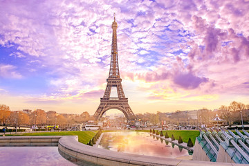 Eiffel Tower at sunset in Paris, France. Romantic travel background